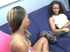 Busty black lesbians with strapon in orgy